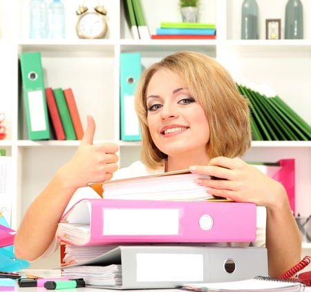 Beautiful young business woman working in office Stock Photo - 21538154