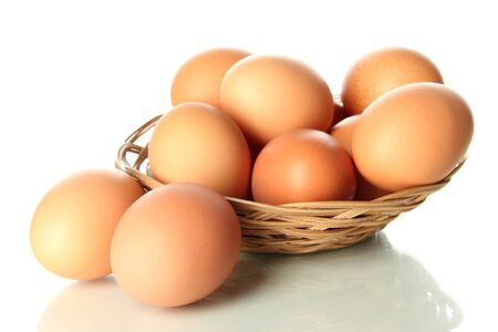 Many eggs in basket isolated on white Stock Photo - 17633750