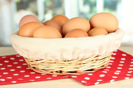 Many eggs in basket on table in room Stock Photo - 17633855