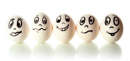 Eggs with funny faces isolated on white photo