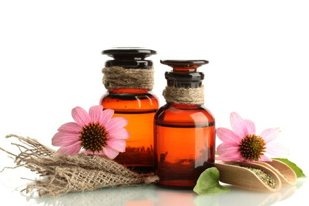medicine bottles with purple echinacea , isolated on white Stock Photo - 17644849