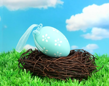 Colorful easter egg on grass photo