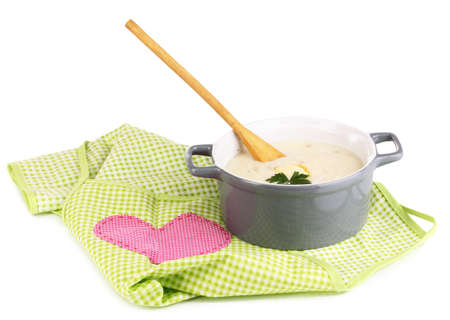 nutritiously: Mashed potatoes in saucepan on green pinafore isolated on white Stock Photo