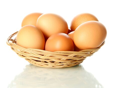 Many eggs in basket isolated on white Stock Photo - 17644624