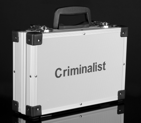 Silvery diplomat (suitcase) on black background Stock Photo - 17636407