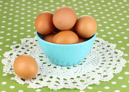 Eggs in bowl on green tablecloth close-up Stock Photo - 17645101