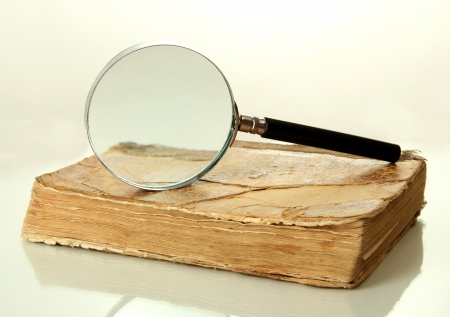 Magnifying glass and book isolated on white Stock Photo - 17650438