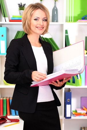 careerists: Beautiful young business woman working in office