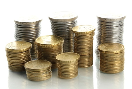 colum: Many coins in columns isolated on white Stock Photo