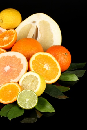 Lots ripe citrus isolated on black Stock Photo - 17650432