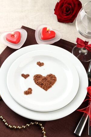 Table setting in honor of Valentine's Day close-up photo