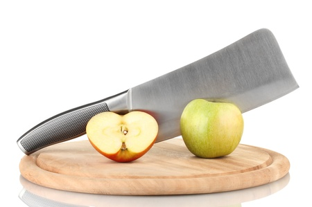 Green apple and knife on cutting board, isolated on white