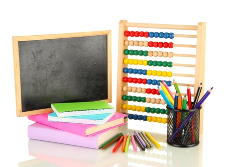 Toy abacus, school desk, books and pencils, isolated on white photo