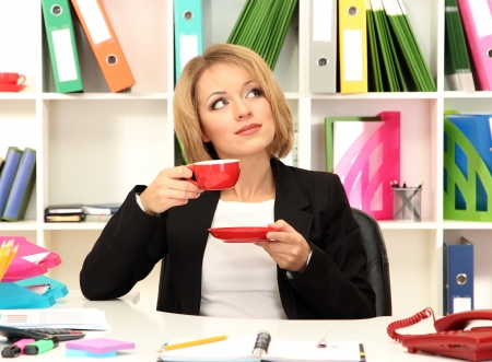 Beautiful young business woman at lunch break in office Stock Photo