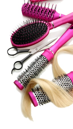 Comb brushes, hair and cutting shears, isolated on white Stock Photo