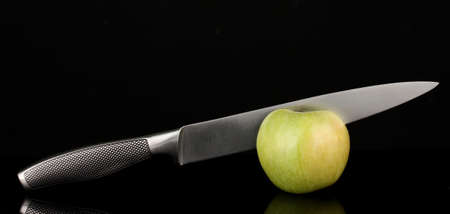 Green apple and knife on isolated on black Stock Photo