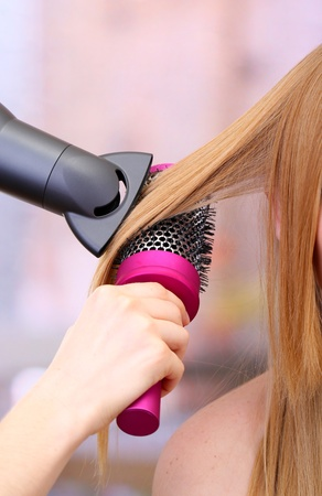 Beautiful woman and hands with hairdryer in beauty salon Stock Photo - 17728381