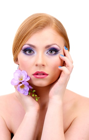 Beautiful young woman with glamour make up and flower, isolated on white photo