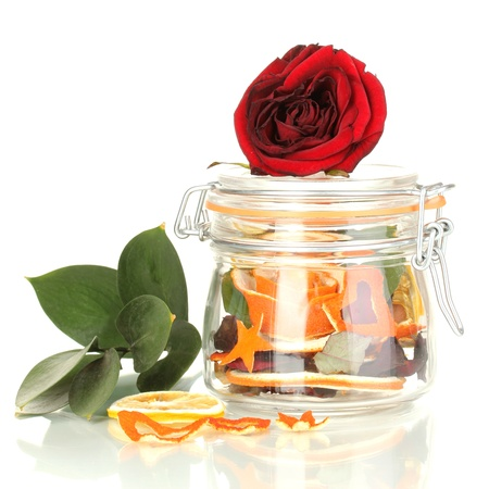 Decorative rose from dry orange peel in glass vase isolated on white photo