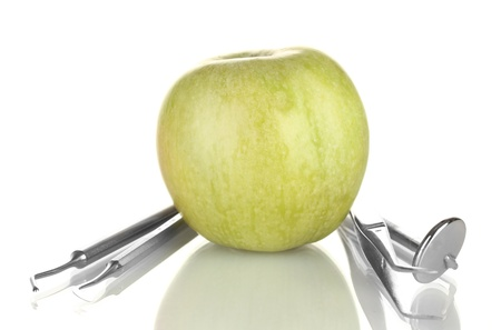 Green apple and dental tools isolated on white Stock Photo - 17760524