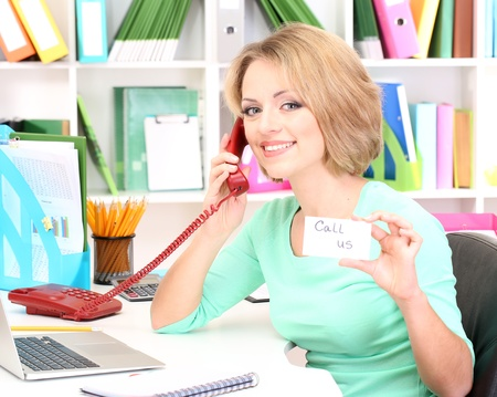 Beautiful young business woman working in office Stock Photo - 21538790