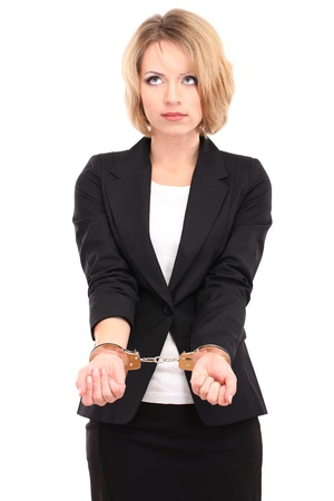 handcuff: Young beautiful business woman in handcuffs isolated on white