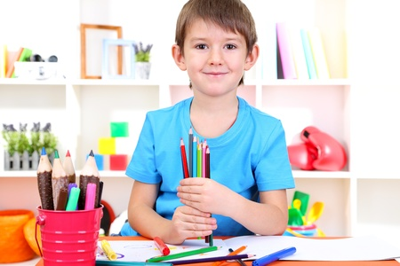 Cute little boy drawing in his album Stock Photo