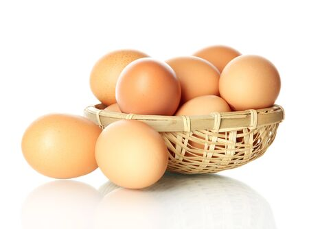 Many eggs in basket isolated on white Stock Photo - 17760556