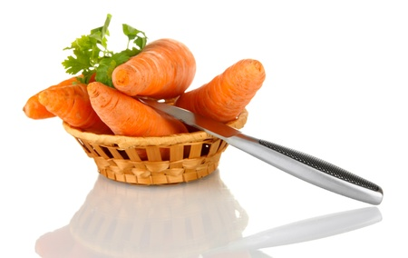 carrots with knife  in basket isolated on white photo