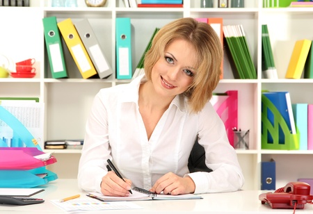 Beautiful young business woman working in office Stock Photo - 21538904