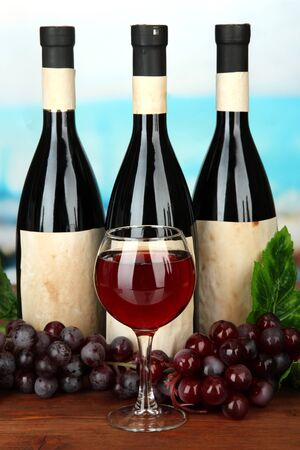 Composition of wine bottles, glass and  grape, on bright background Stock Photo - 17760977