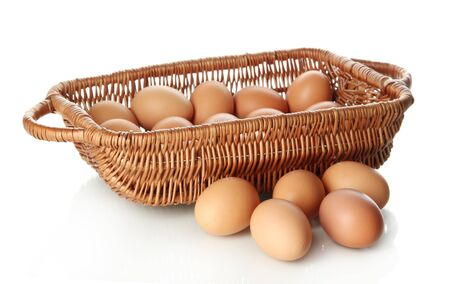 Many eggs in basket isolated on white Stock Photo - 17760923