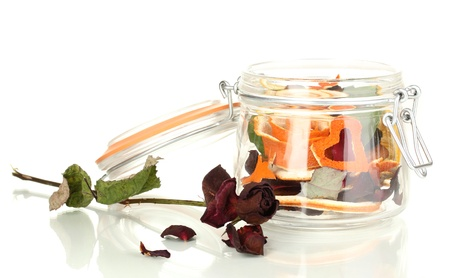 Decorative rose from dry orange peel in glass vase isolated on white Stock Photo - 17760896