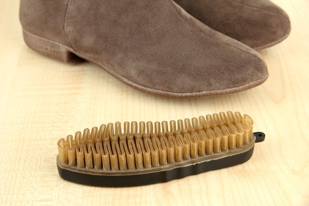Brush for suede shoes, on wooden background Stock Photo - 17761028