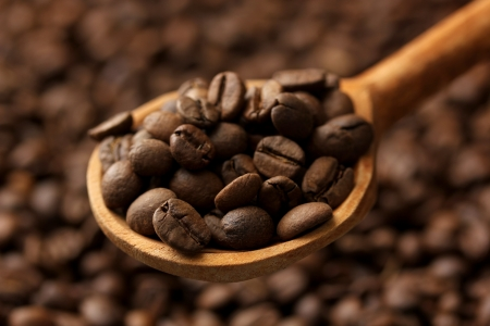 Coffee beans in wooden spoon, close up Stock Photo - 17761008