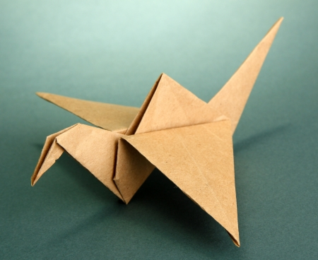 Origami crane on grey background photo