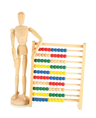 Bright toy abacus and wooden dummy, isolated on white Stock Photo - 17769911