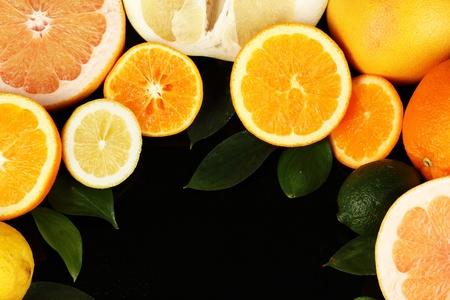 Lots ripe citrus isolated on black Stock Photo - 17770180