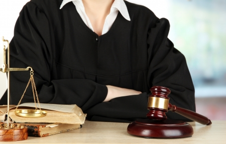 Judge sitting at table during court hearings on room background Stock Photo - 17770078