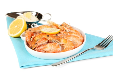 Shrimps with lemon on plate isolated on white photo