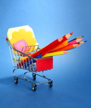 trolley with school equipment on blue background Stock Photo - 17778590