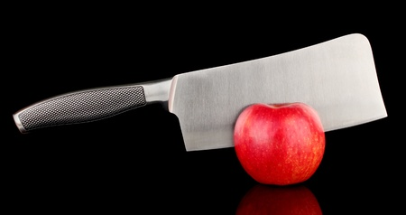 tastyhealth: Red apple and knife on isolated on black