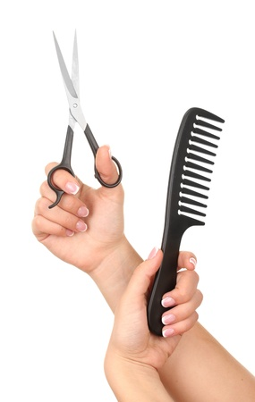 hair cut: Color comb and scissors in female hand, isolated on white Stock Photo