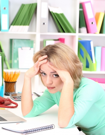 Tired business woman working in office Stock Photo