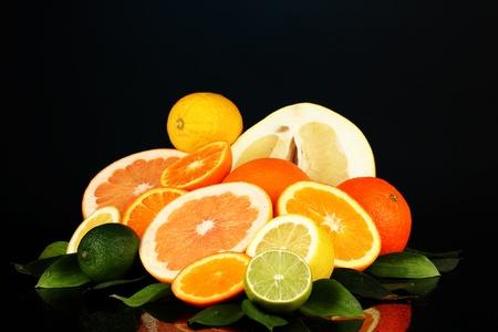 Lots ripe citrus isolated on black photo