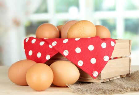 Many eggs in box on table in room Stock Photo - 17778695