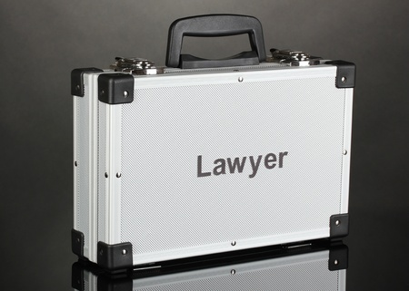 Silvery diplomat (suitcase) on grey background Stock Photo - 17779088