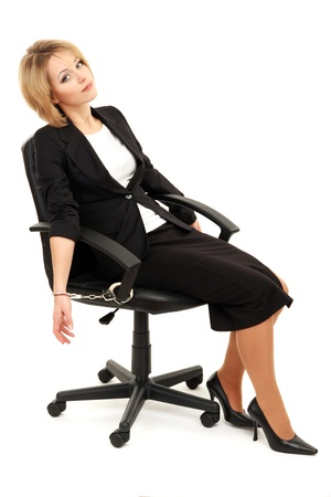 handcuffs woman: Young beautiful business woman strapped to chair with handcuffs isolated on white Stock Photo