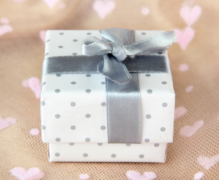 Color gift box with silver ribbon, on color background photo