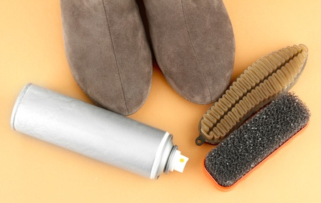 Set of stuff for cleaning and polish shoes, on color background Stock Photo - 17820817